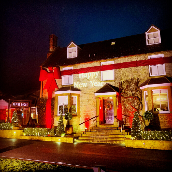 Dormy House Hotel with red bow and new years eve uplighting