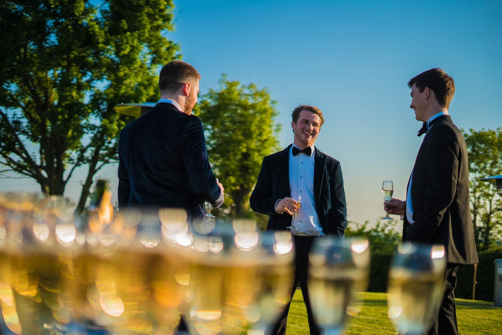 Male partygoers chatting at a drinks reception