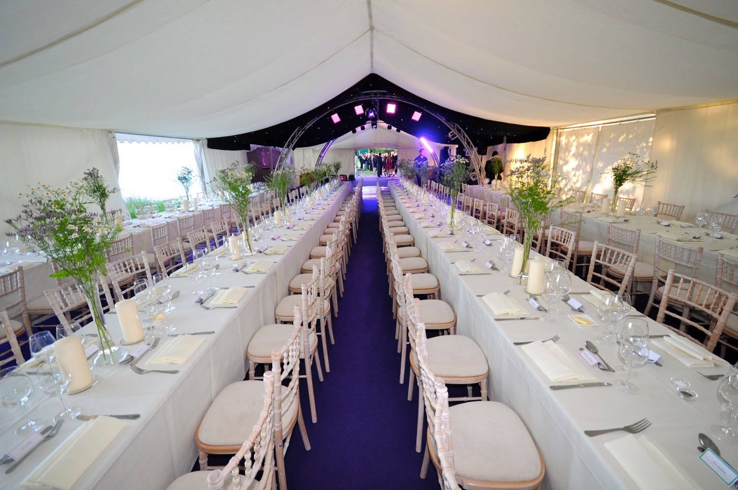 Tables set for lunch inside a marquee