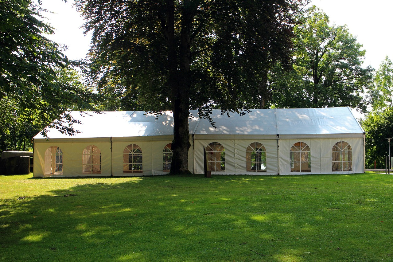 Marquee in summer under trees