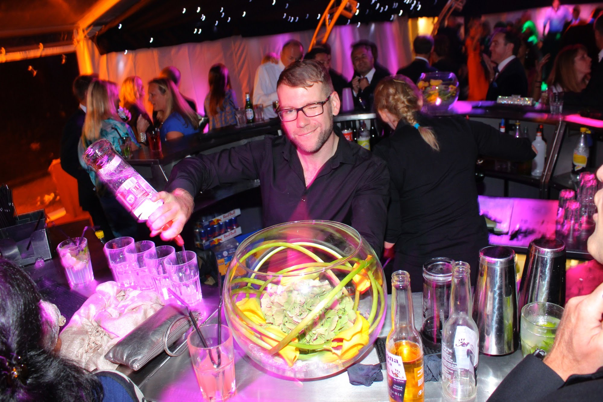 Bartender serving cocktails at a party
