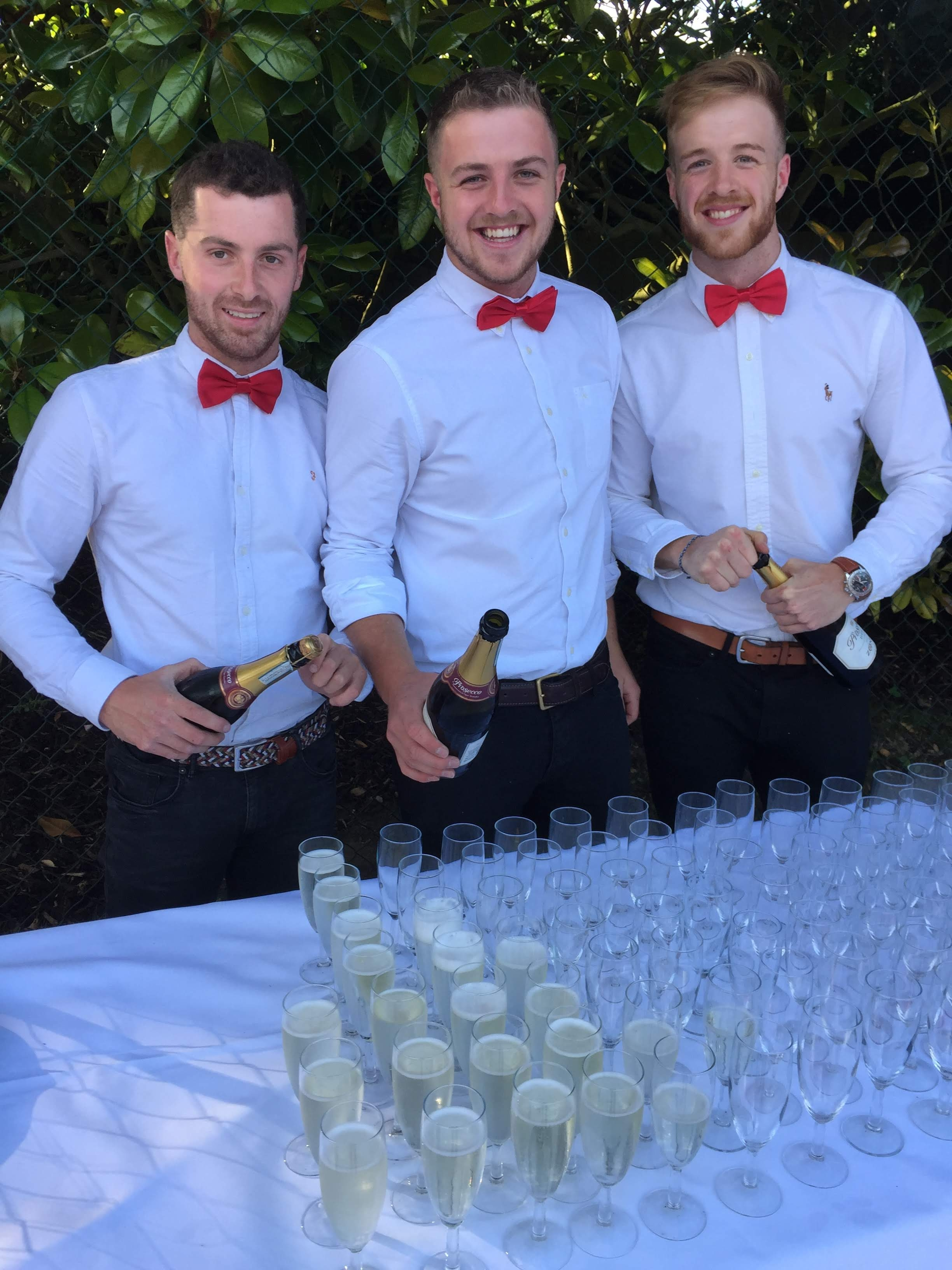Waiter serving champagne from a tray at a party