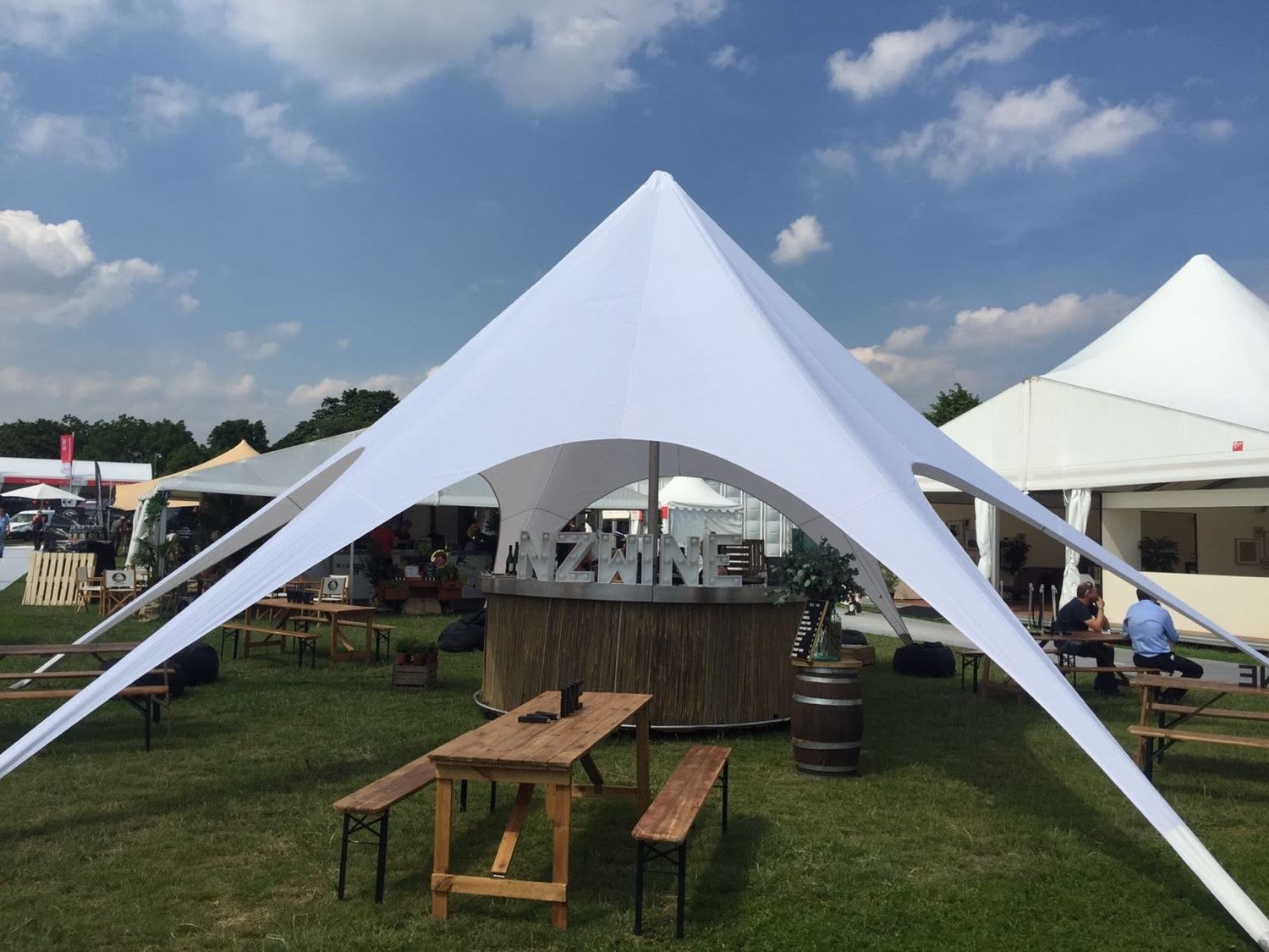 Stretch marquee with round bar at a corporate event
