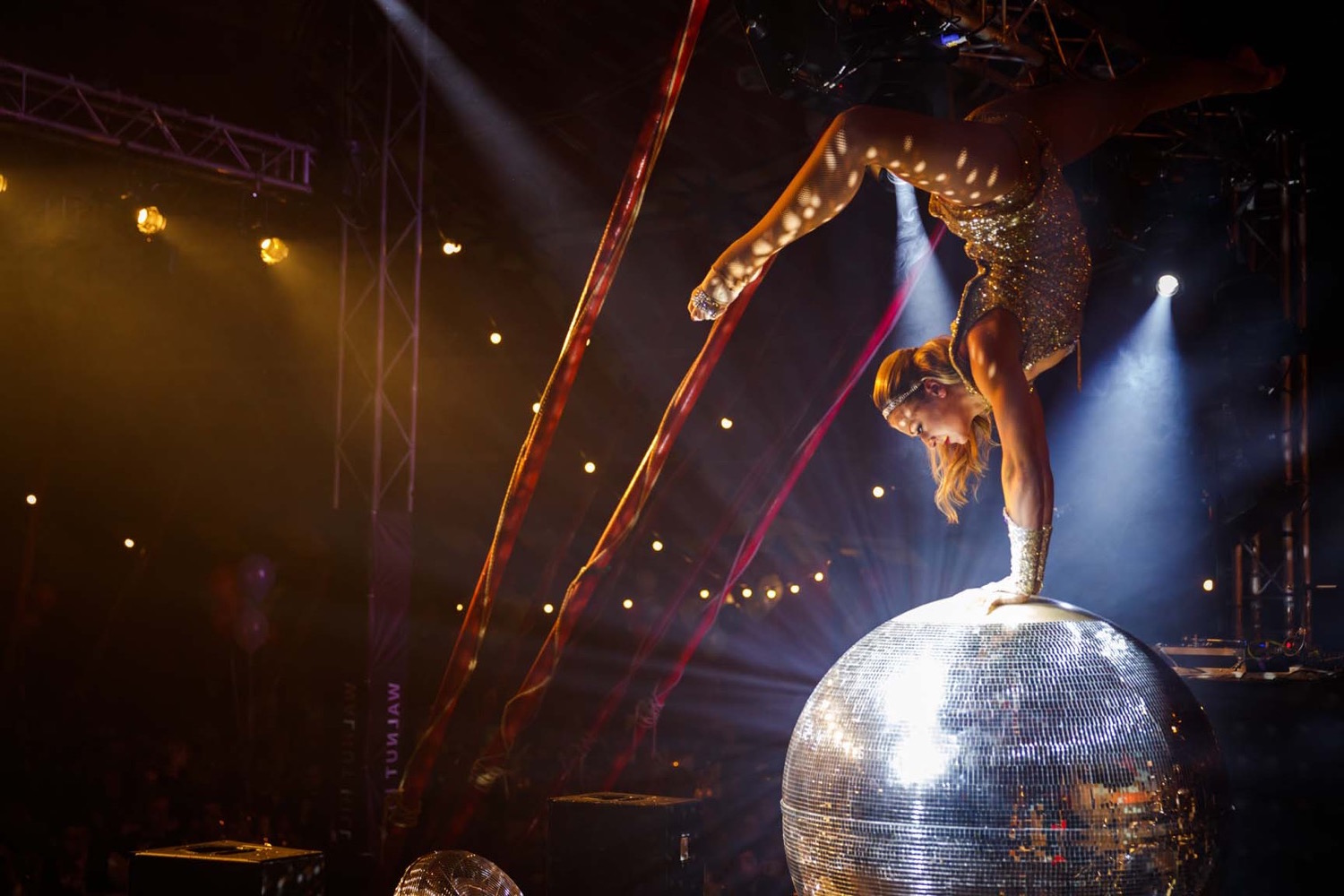 Gymnastic dancer on a glitterball at a party
