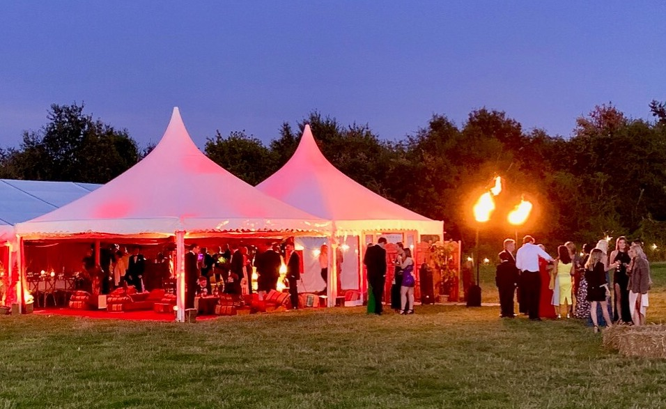 Marquee Party at Dusk with marquee lighting and straw bales