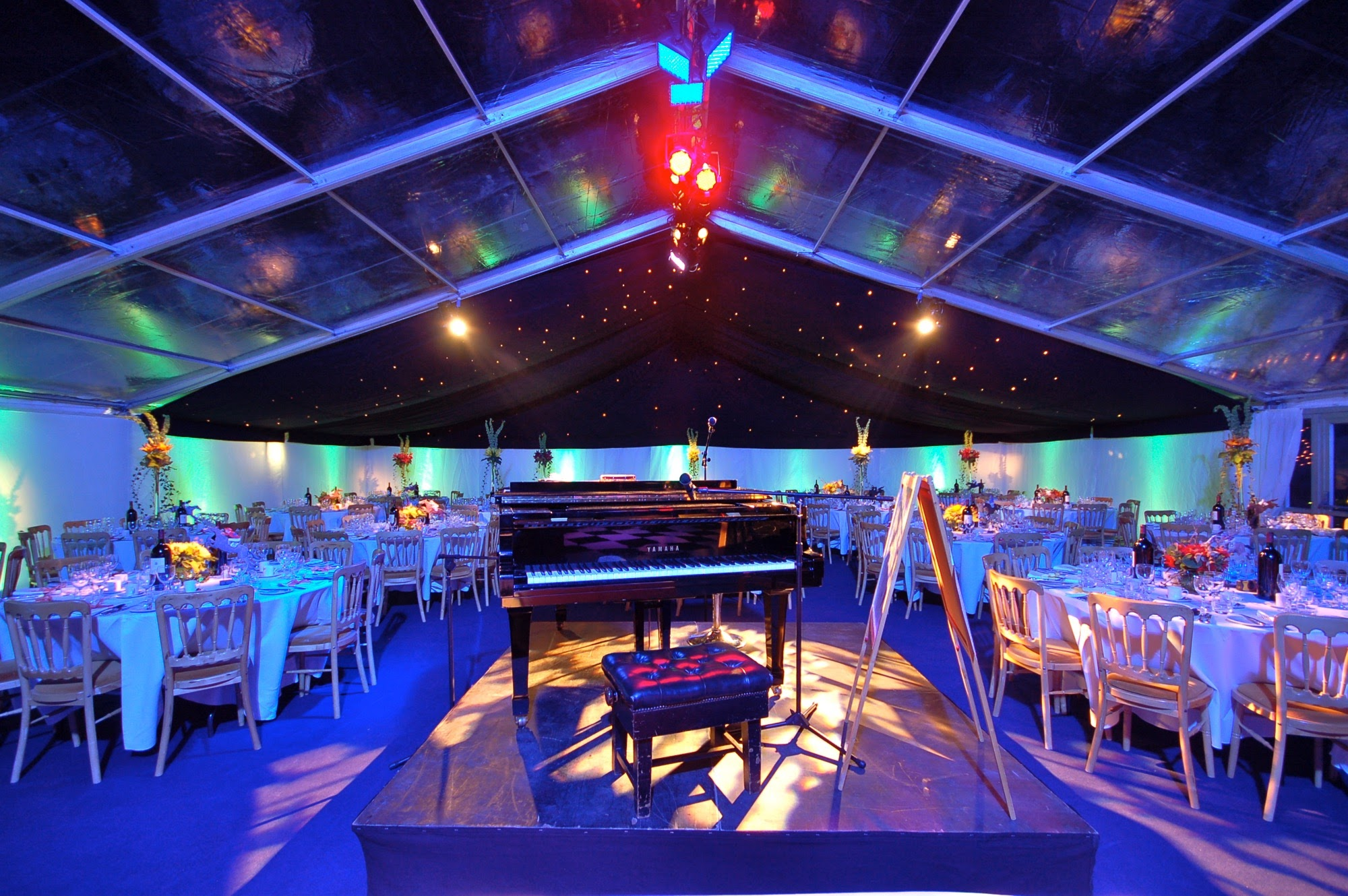 Marquee with piano centrepiece and clear roof