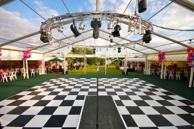 Marquee with clear roof and dancefloor ready for partygoers