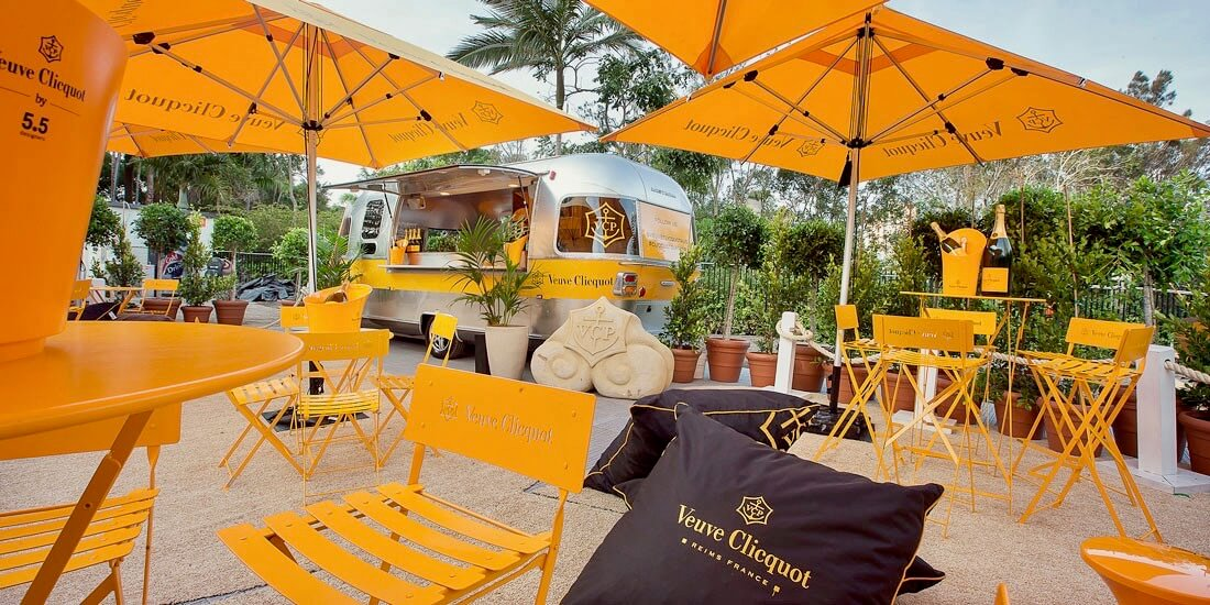 Veuve Clicquot patio furniture party set up with silver airstream bar